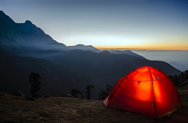A sunset over a tent
